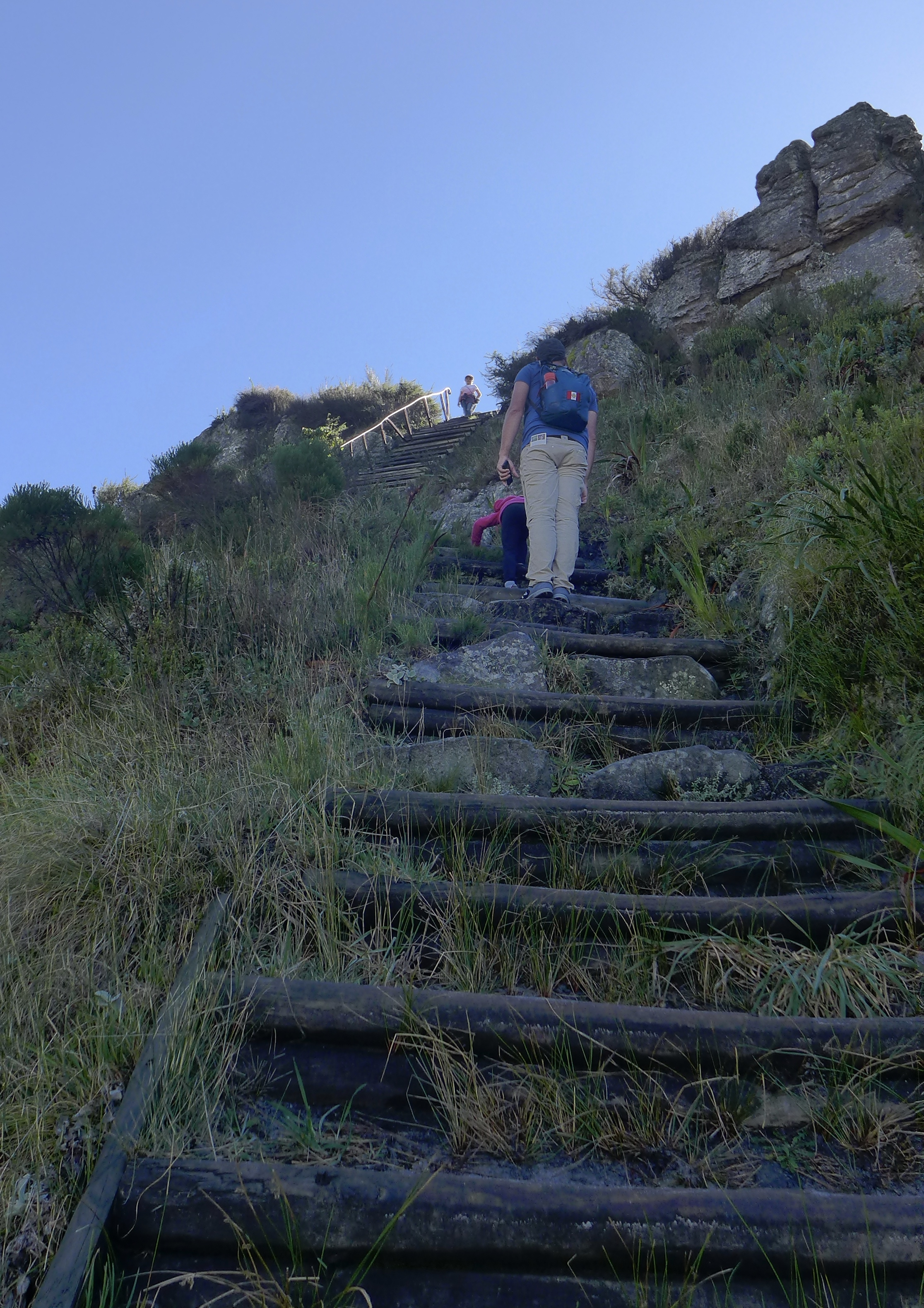 View from below as Jacob and the girls climb the steep staircase on the side of the mountain