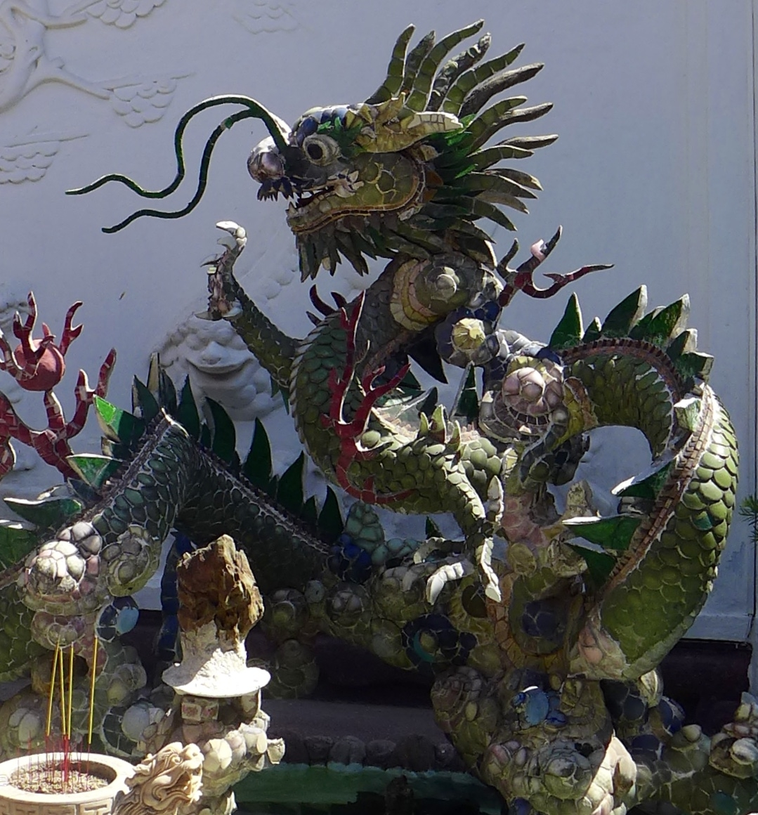 Green dragon sculpture with long whiskers